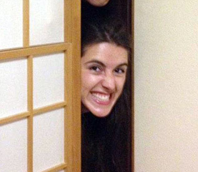 Smiling as she peers around a door, this is one of the eccentric pictures which have emerged of Natalie Holt, the backing musician who pelted Simon Cowell with eggs