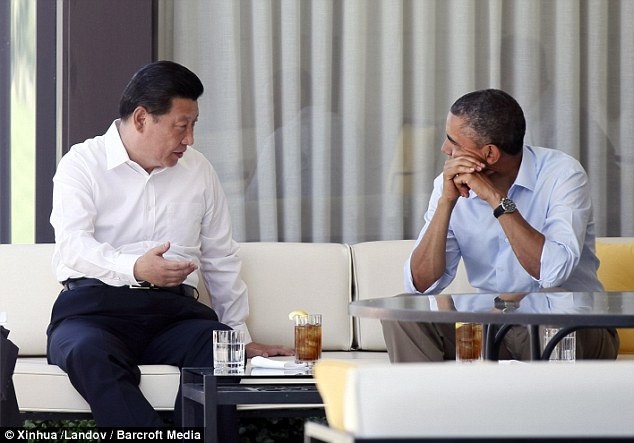 Private talks: U.S. President Barack Obama, pictured right, spent eight hours over two days discussing climate change, cybersecurity and North Korea