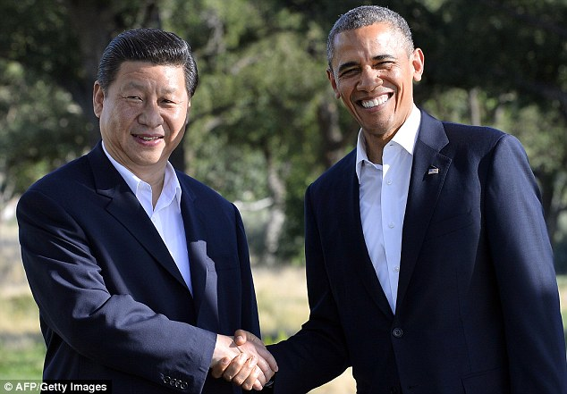 Agreement: U.S. President Barack Obama, pictured right, confronts China President Xi Jinping on cybersecurity but both agree to tackle climate change and take action on North Korea
