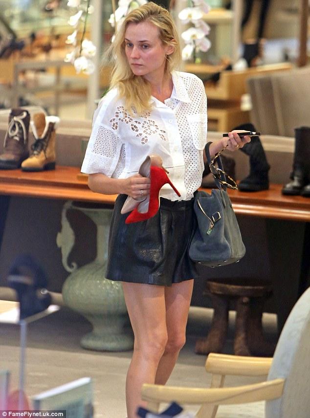Diane Kruger Contemplates Neiman Marcus Assortment As She