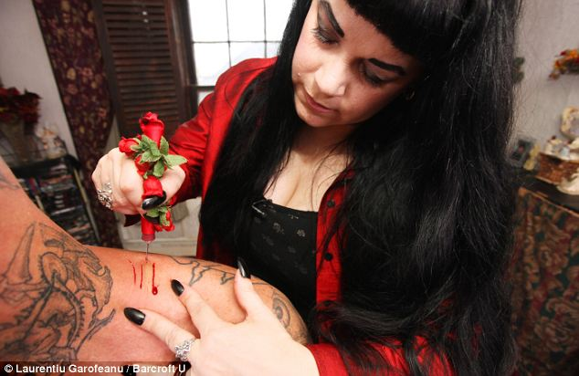 Bizarre hobby: Ms Caples' drinking sessions take place at her home, where she cuts the donor with a pagan-like sterilized knife she designed herself