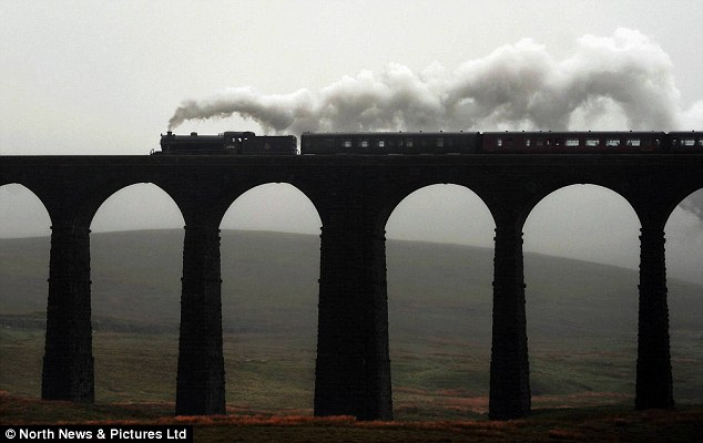 The Great Marquess steam locomotive cuts her way across gloomy skies