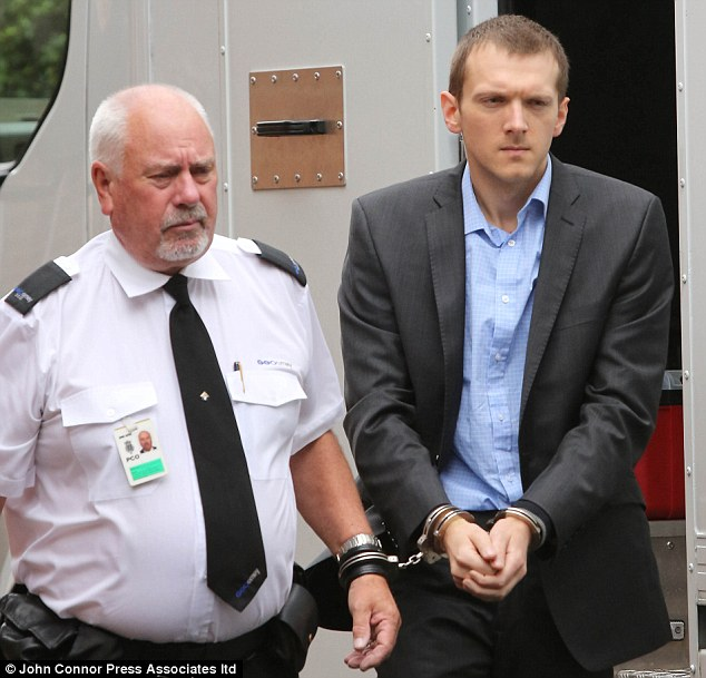 Entrance: Jeremy Forrest arrived at Lewes Crown Court today with a guard for the third day of his trial