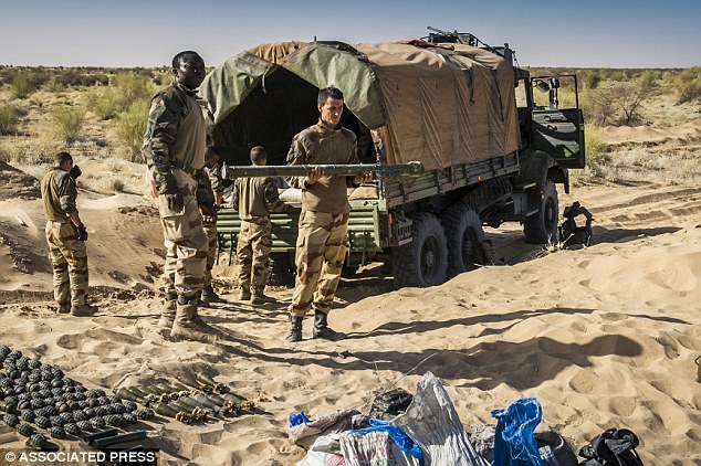 Deadly: A French soldier holds a SA-7 surface-to-air missile launcher in Timbuktu, Mali. The weapon is feared to be in the hands of Al Qaeda after a manual was found at a terror training camp in the town