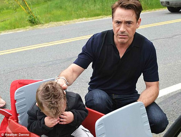 Disappointment: Little superfan Jaxson Denno was in floods of tears when he met Iron Man star Robert Downey Jr... because he wasn't in his suit