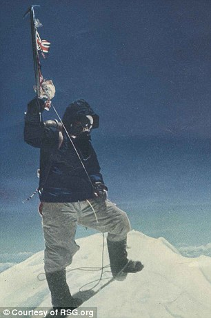 Top of the world: Norgay was captured by Hillary on May 29, 1953 standing at the summit of Mt Everest, wearing the high performing boots