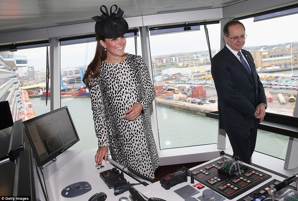 Captain Kate: The Duchess tries out a few buttons up on the Royal Princess' bridge much to the delight of Princess Cruises CEO, Alan Buckelew