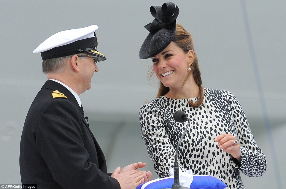 Having a smashing time: The Duchess laughs with the Royal Princess' commanding officer, Captain Tony Draper, after launching the Nebuchednezzar at the ship
