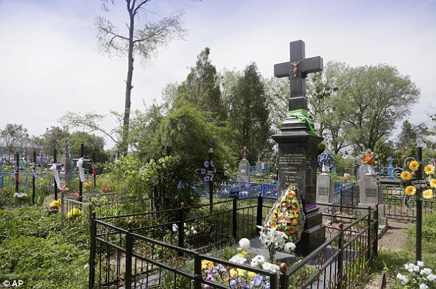 This monument pays tribute to Ukraine civilians burned alive by German troops during the war - evidence suggests Mr Karkoc's unit was in the area at the time of the massacre