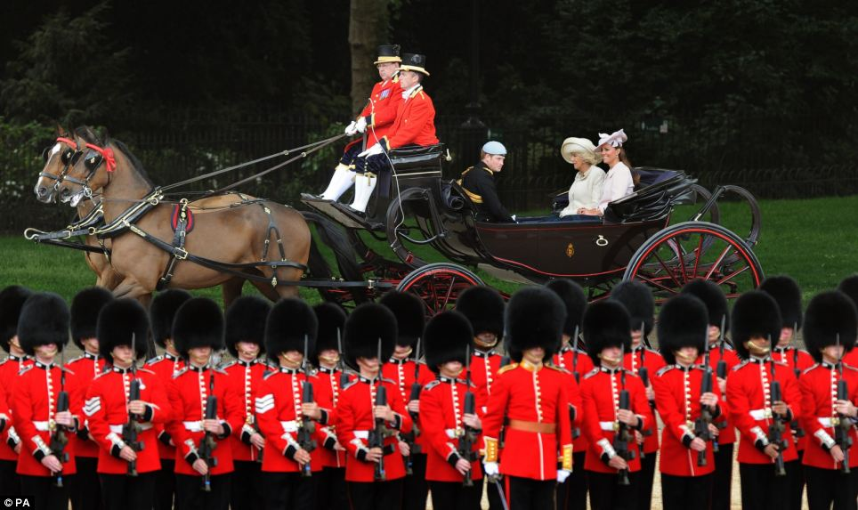 The Royal family were driven in a horse and carriage as they rode through the tree-lined Mall, as soldiers marched in a precise formation to celebrate the monarch's official birthday
