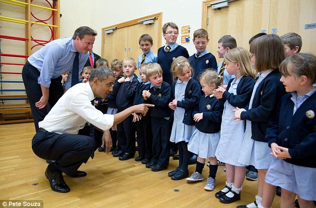 Making new friends: Obama and British Prime Minister David Cameron visit a primary school in Northern Ireland