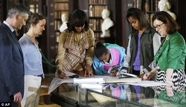 Thrilled, girls? First Lady Michelle Obama and her daughters, Sasha (center) and Malia (right) tour the Old Library Building at Trinity College in Dublin on Monday