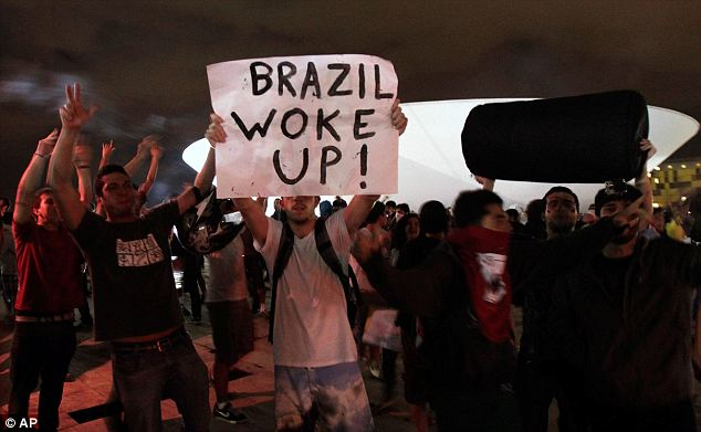 Rising: Demonstrators shout slogans during a protest in front of the Brazilian National Congress in Brasilia