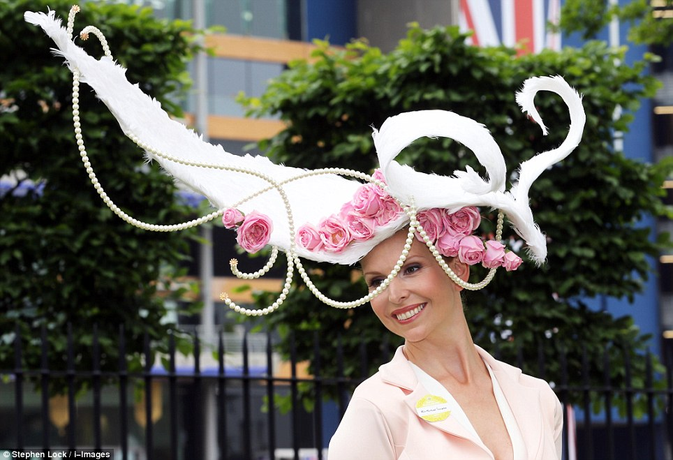 Opulent: Racegoer, Anneka Tanaka-Svenska, sports big pink blooms combined with ropes of pearls on her utterly spectacular hat