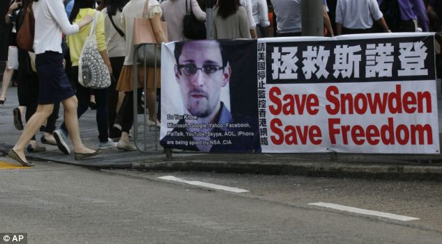 Support: Snowden's image is displayed in Hong Kong, where the whistleblower has been in hiding