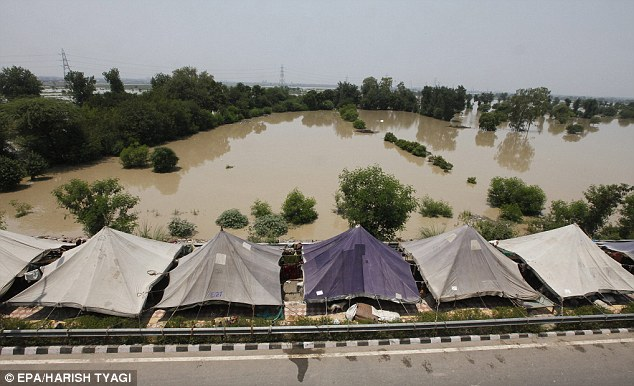 Emergency tenting erected by the Delhi government next to the flooded area of Yamuna River. Low lying areas were flooded as the water level in the river has increased above the danger mark