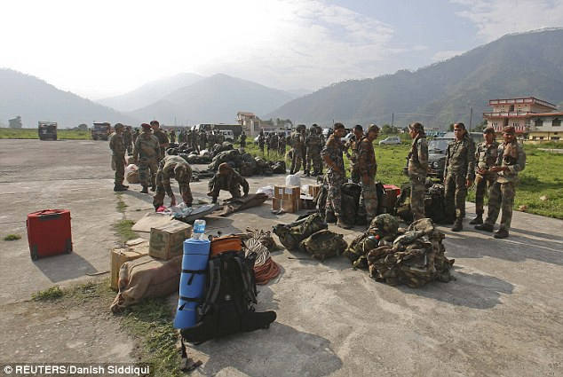 Indian Army Paratroopers prepare to leave for rescue operations at an airfield in Gauchar