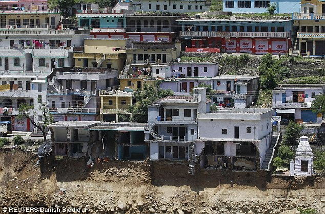 Damaged houses are seen at a village in Rudraprayag in the Himalayan state of Uttarakhand
