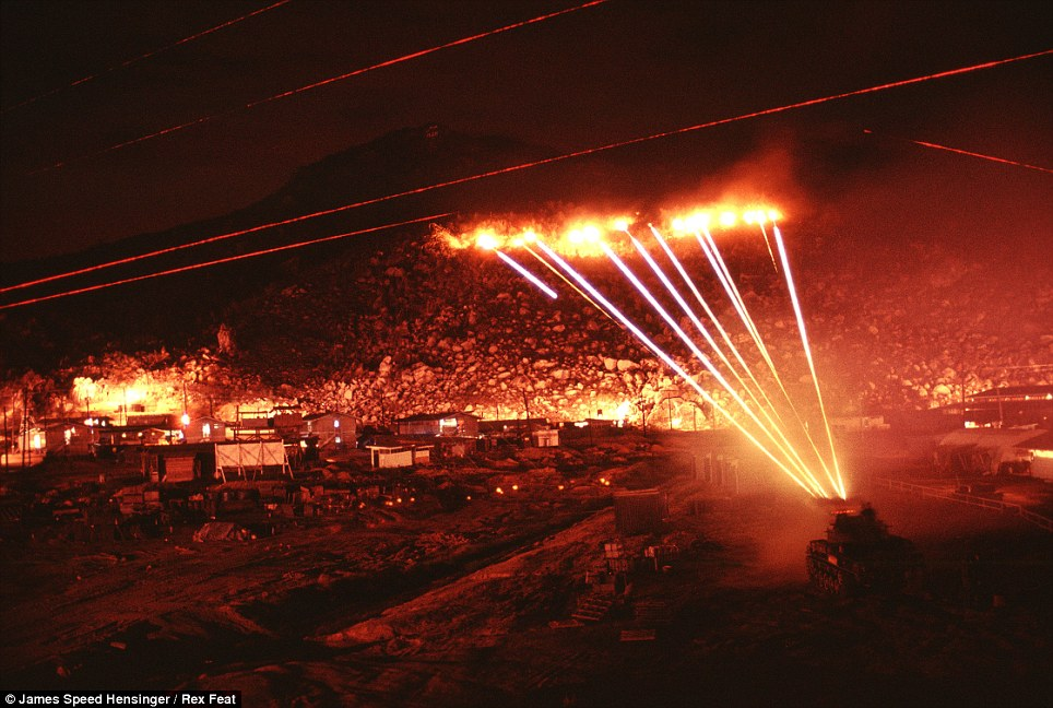 The M42 tank's .50-caliber machine guns up fire - lighting up the hills. The soldiers didn't know there the sniper was - they were hoping to hit him with the massive barrage