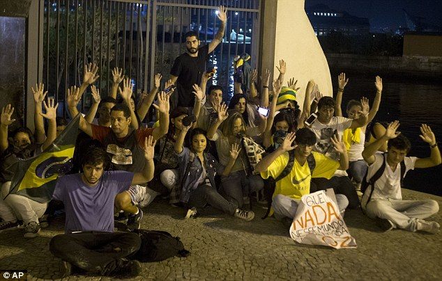 People power: Protesters raise their hands to show they are not armed amid massive anti-government demonstrations sweeping Brazil