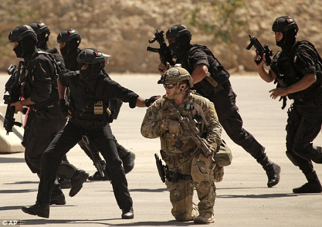 Training: American troops join Jordan and Iraq for an exercise as it is revealed Syrian rebels are being helped