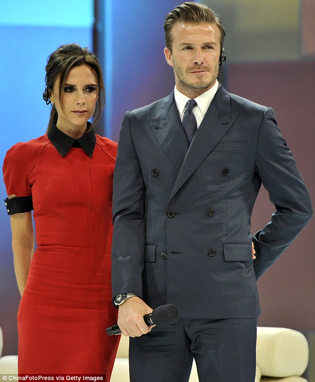 Show of support: Victoria is in China to promote her fashion line as well as support David who is am ambassador for the football league