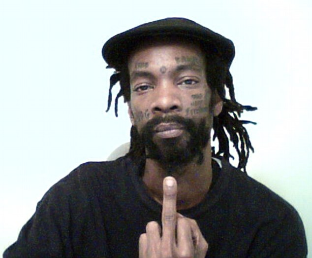 Maruse Heath, seen here giving the middle finger to the camera, is a leader in the New Black Panther Party who was arrested in New York City for possession of an unlicensed, loaded handgun