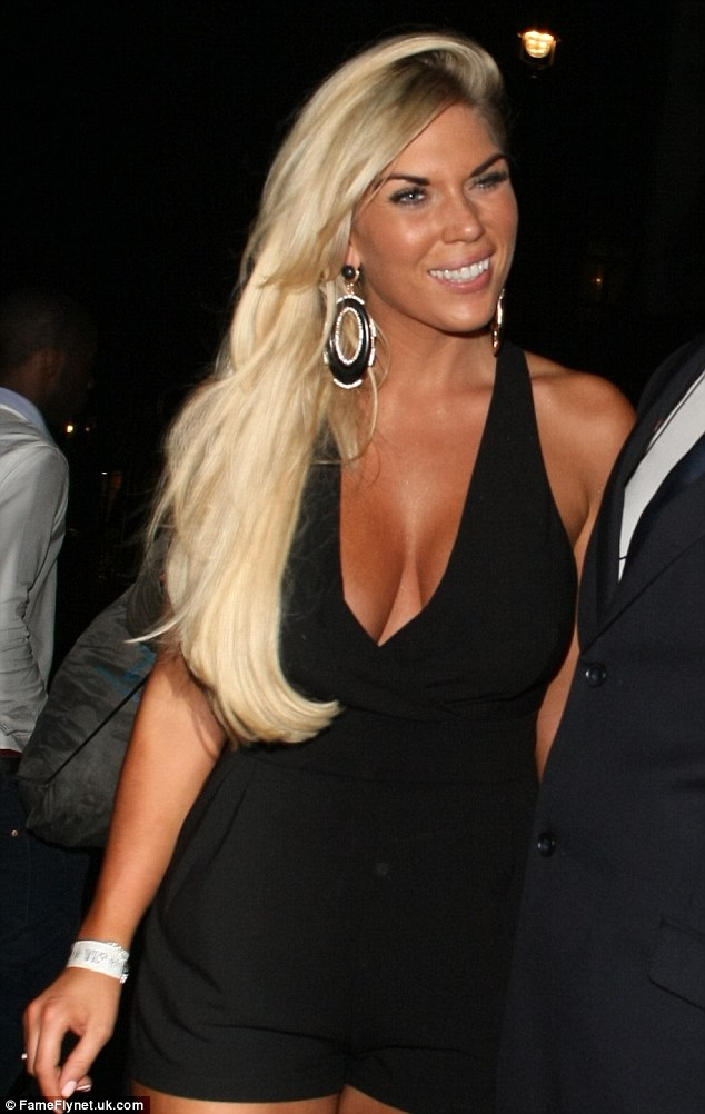 In check: Frankie Essex shows off her cleavage in a plunging halterneck playsuit