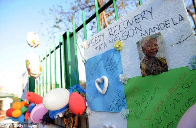 Well-wishers: Balloons and letters wishing Nelson Mandela well are displayed at the entrance of the Medi-Clinic Heart Hospital in Pretoria, where the former South African President is being treated