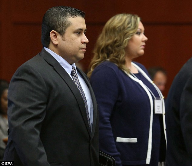 D-Day: George Zimmerman arrives in Seminole circuit court with his wife Shellie on the first day of the trial, when explosive opening statements will be heard