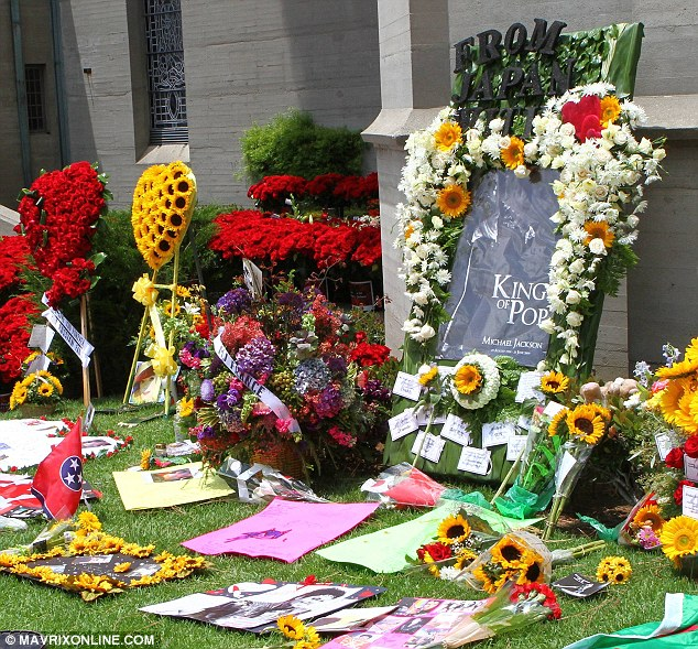Remembering an icon: Piles of flowers were left by Michael Jackson fans on Tuesday at the Forest Lawn cemetery in Los Angeles on the fourth anniversary of his death