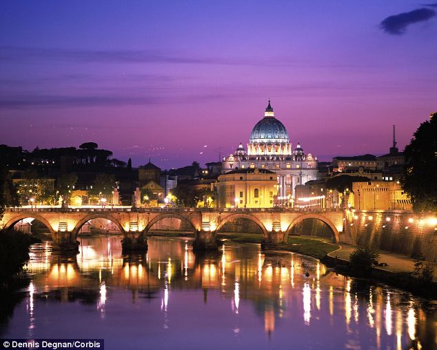 Vatican City at dusk: Francis, who has made clear he wants a 'poor' church, has already named a separate commission of cardinals to advise him on the broader question of reforming the Vatican bureaucracy as a whole