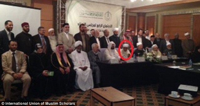 Shaykh Abdallah bin Bayyah, circled in red, is shown at the December 2012 International Union of Muslim Scholars' board meeting in Doha, Qatar. Yusuf al-Qaradawi is shown to his left (camera-right)