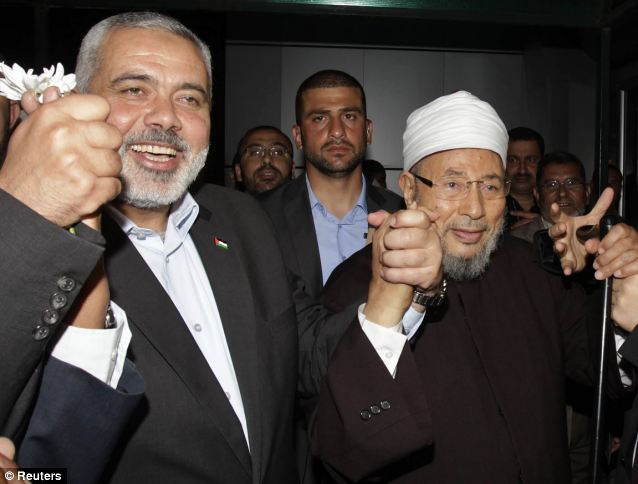 Yusuf al-Qaradawi (R), shown with Hamas Prime Minister Ismail Haniyeh (L), leads the International Union of Muslim Scholars. His second-in-command was welcomed into the White House on June 13