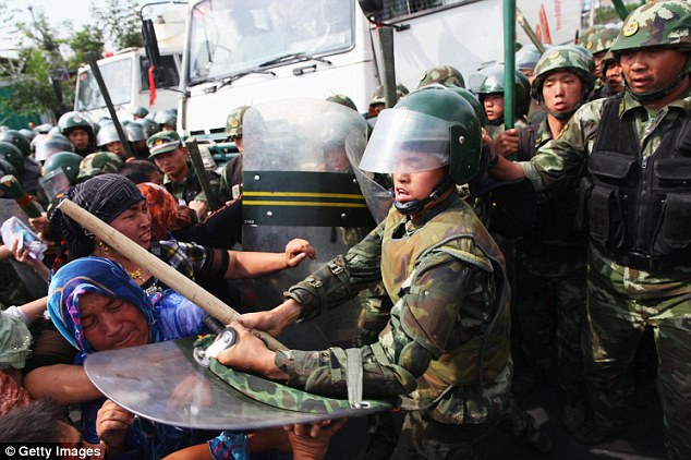 Restive: Violence erupted in the remote western Xinjiang region, where there were protests in 2009 (pictured) after riots pitting Muslim Uighurs against ethnic Chinese left nearly 200 dead (file photo)