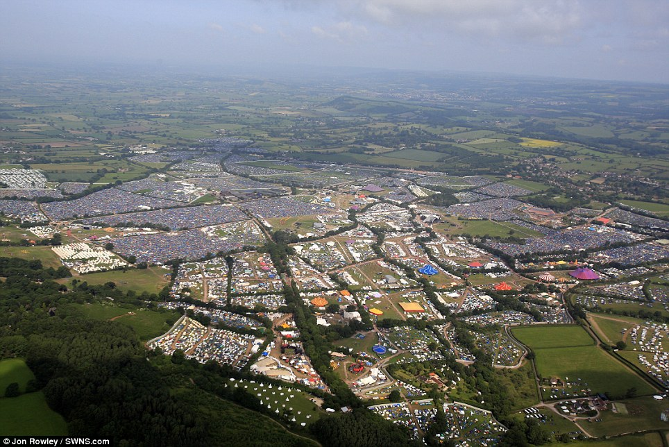 Sweeping views: Aerial photograph of the vast temporary city which has sprung up at the Glastonbury Festival on a dairy farm in Somerset