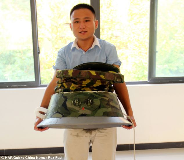 Pu Qingliang, 21, carrying his foldable washing machine and motorised base.