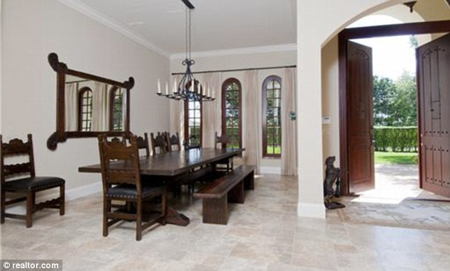 Grand entrance: Oversized doors open on to a reception area large enough to seat ten people for dinner