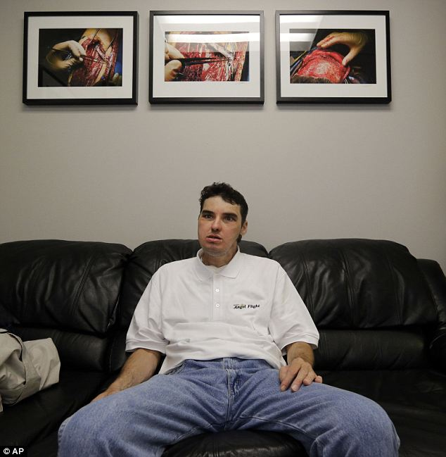 Grateful: Norris sits in the office of Dr. Eduardo Rodriguez, who led the surgical team that performed the face transplant