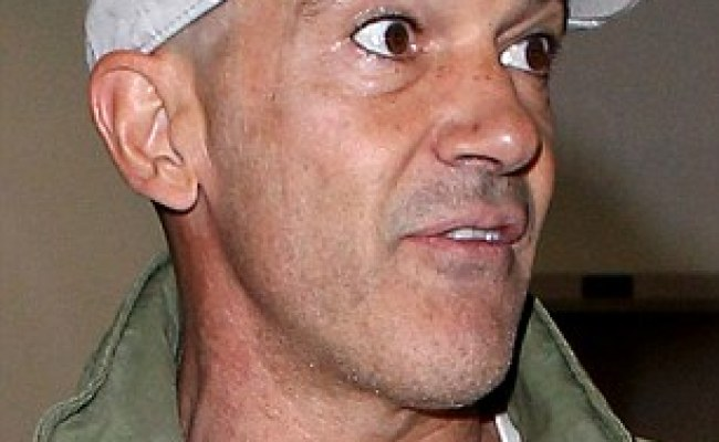 Antonio Banderas Keeps Shaven Headed Look Under His Hat