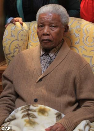 Critical: Neslon Mandela, pictured here in May, cannot breathe unaided