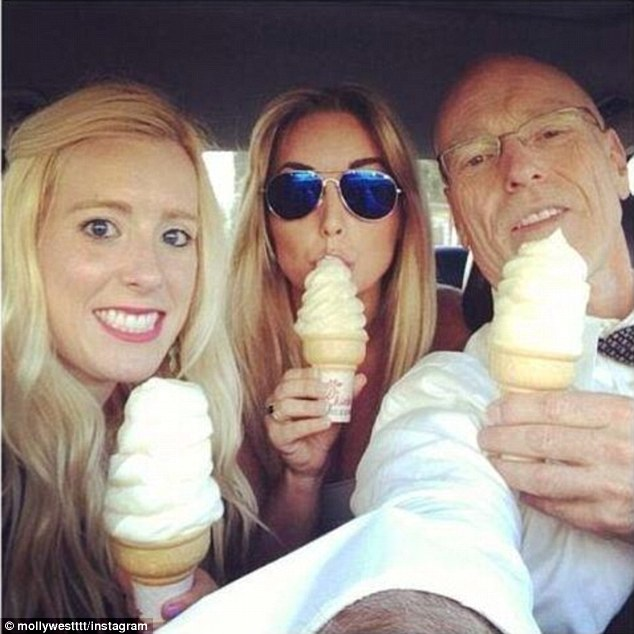 Courtroom drama: George Zimmerman's lawyer, Don West, was pictured enjoying ice cream with his daughters during a break in the murder trial