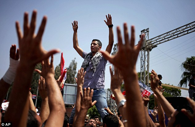 Waving Egyptian flags, crowds descended on Tahrir Square in the heart of Cairo to demonstrate