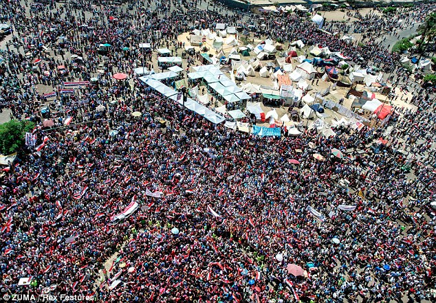 Members of opposition groups attend an anti-President Mohamed Morsi rally at Tahrir Square