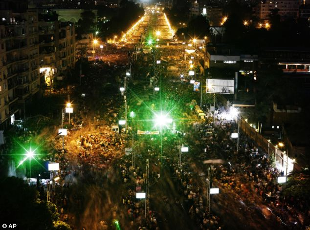 As nightfall came to Cairo, opponents of Egypt's President Mohammed Morsi protest were still gathered in their thousands outside the presidential palace