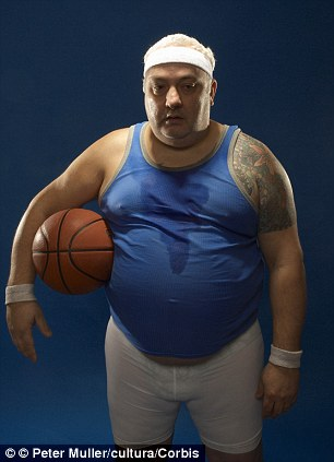Large sportsman holding basketball --