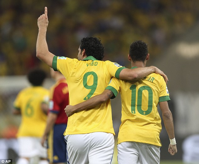 Come here, you: Neymar and Fred celebrate the third of the evening at the Maracana
