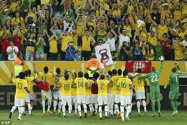 Drink it in: Brazil's players celebrate in front of their own fans after securing the victory