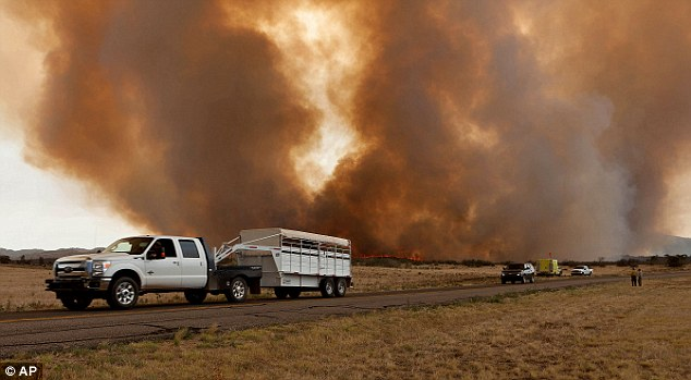 Escape: Homeowners packed up any belongings they could as they fled the wildfire