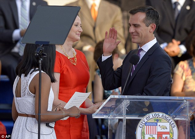 Fresh blood: Garcetti, right, is sworn as mayor of Los Angeles by 8th grader Kenia Castillo, left, as his wife Amy Wakeland looks on in front of city hall, Sunday, June 30, 2013, in Los Angeles